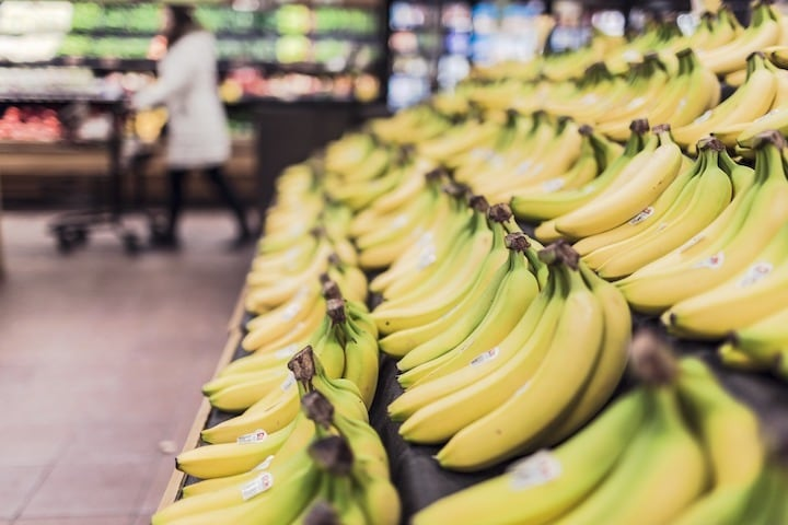 Bananas on grocery store shelf