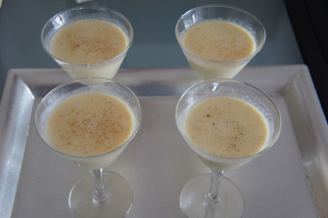 four servings of vegan eggnog served in martini glasses