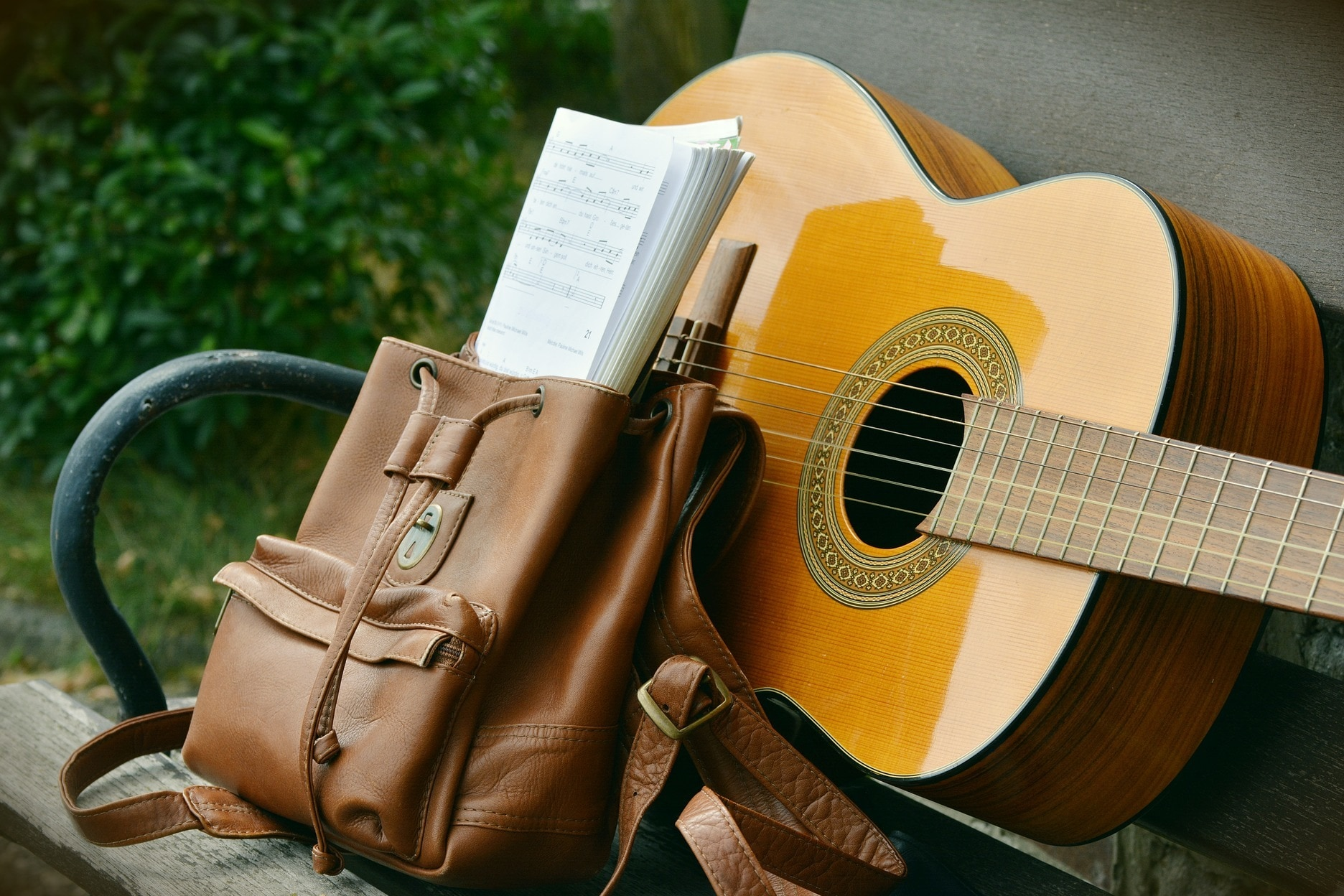 Guitar and a bag with sheet music