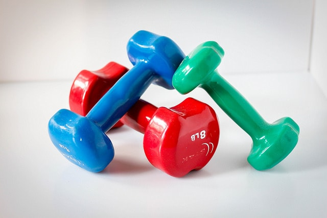 set of colorful dumbbells on the floor