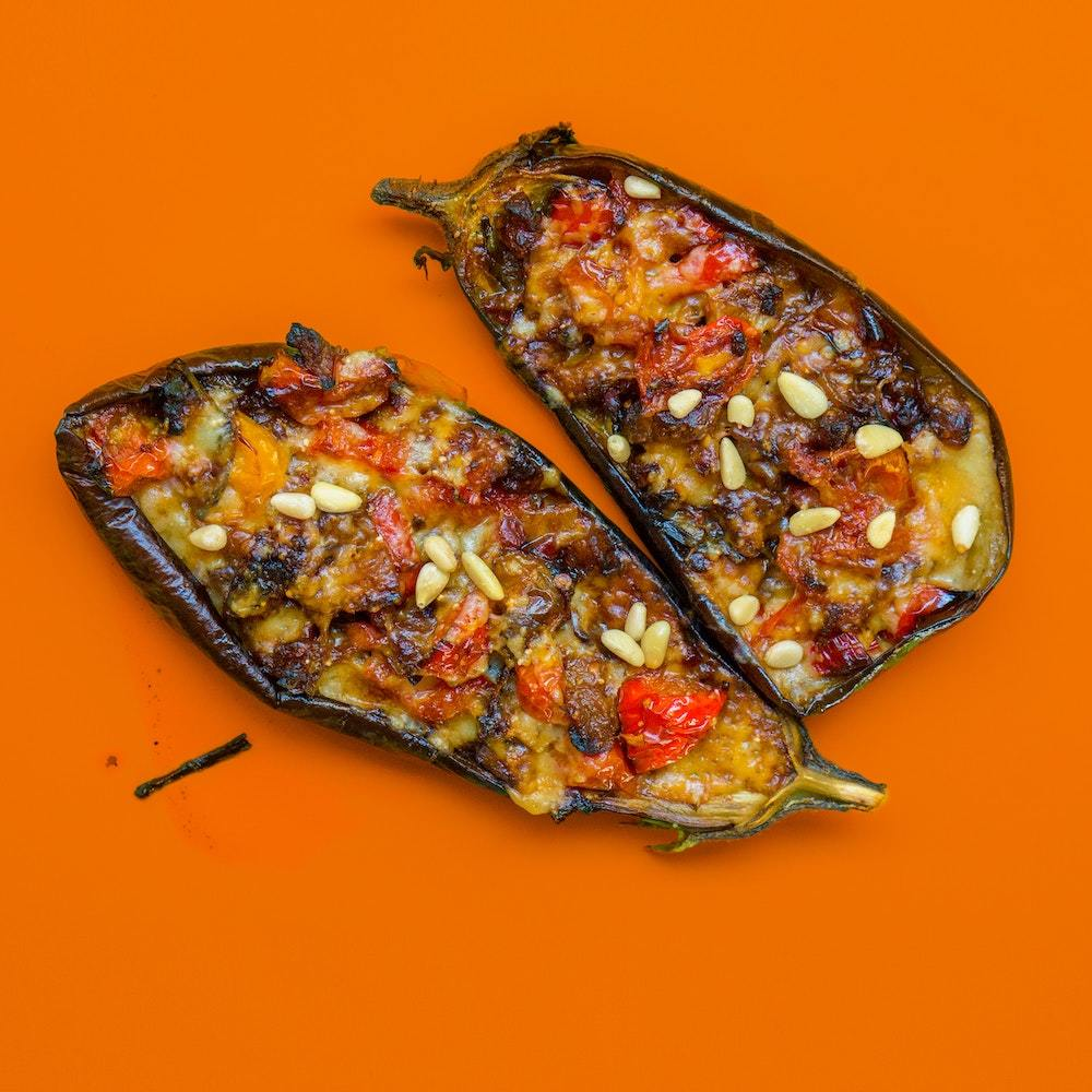 stuffed eggplant on orange background