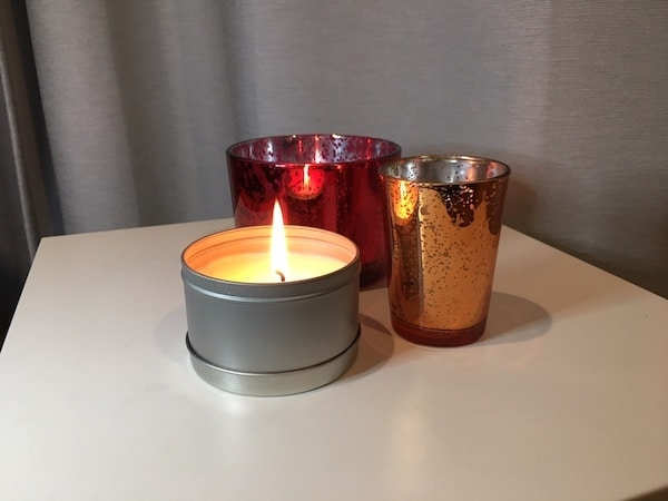 Scented candles can make your space cozy and create a focus point.