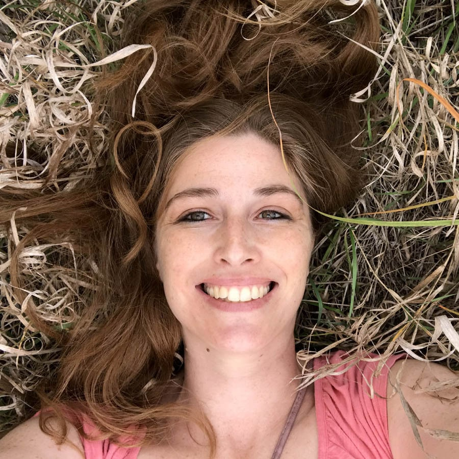author Angela Tague lying in the grass