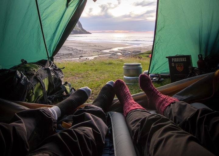 Two people in tent on camping trip