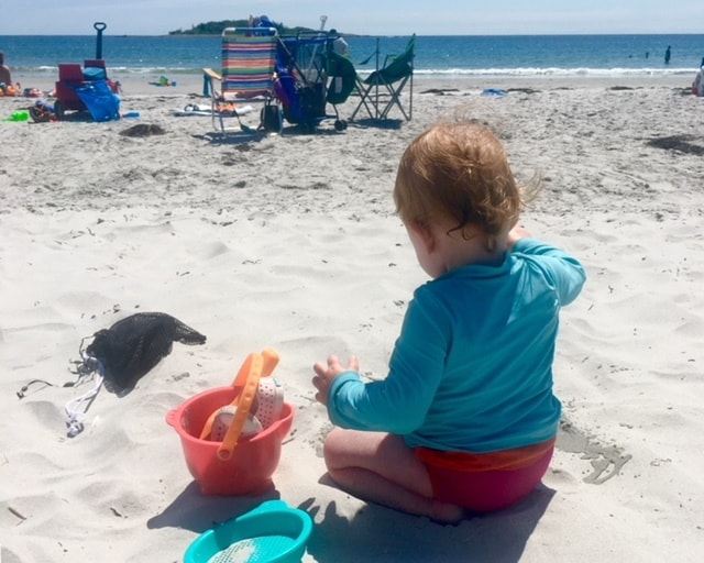 baby on beach in hot weather