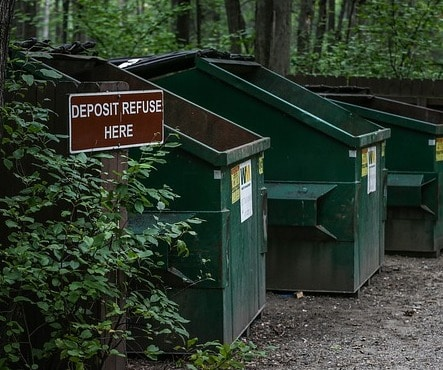 Recycle and waste bins at campground.