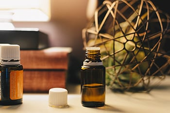 two bottles of wintergreen oil sitting on table