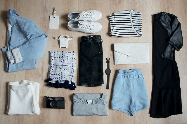 capsule wardrobe laid out on a bad