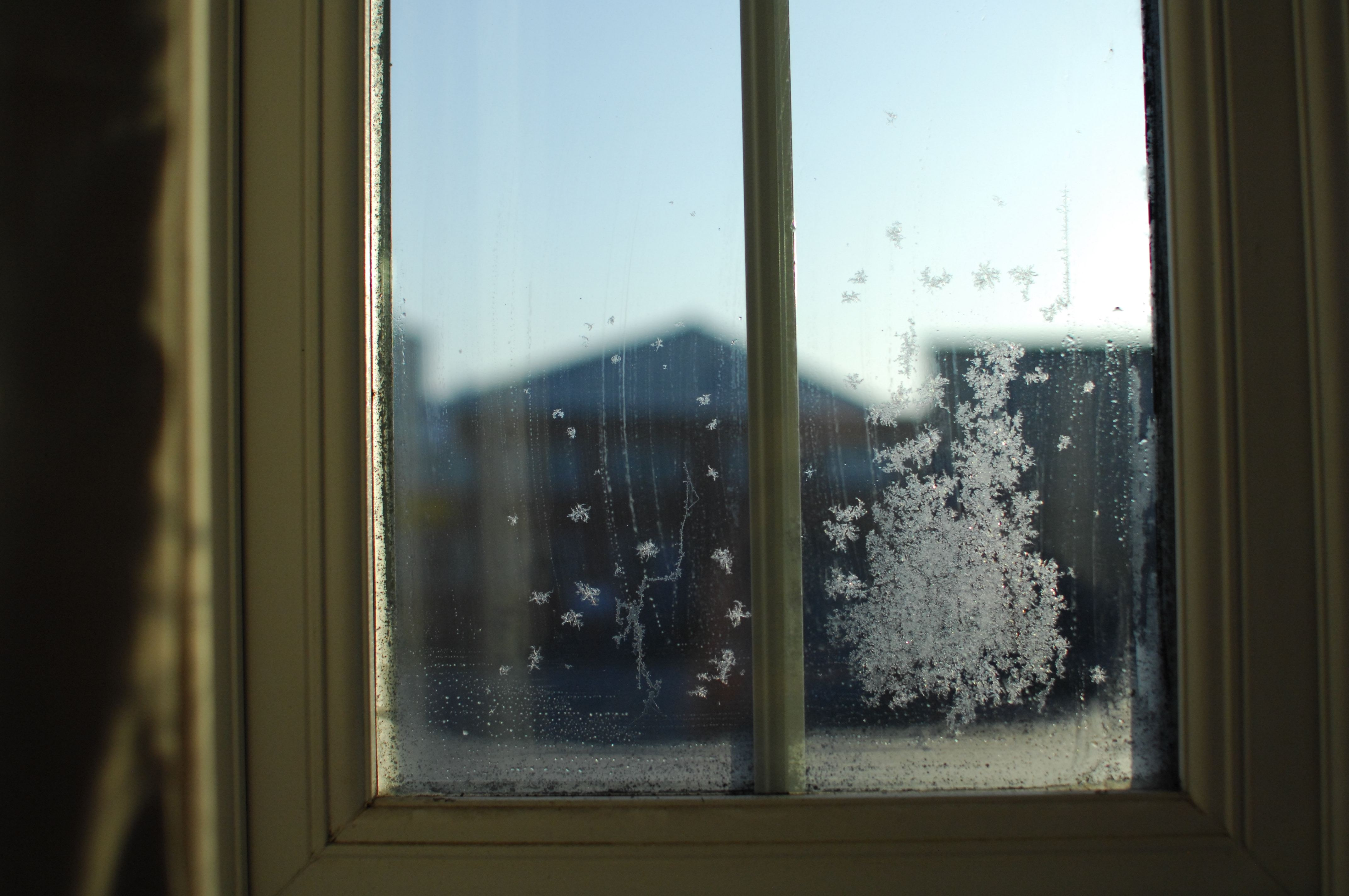ice on window panes with yellow trim