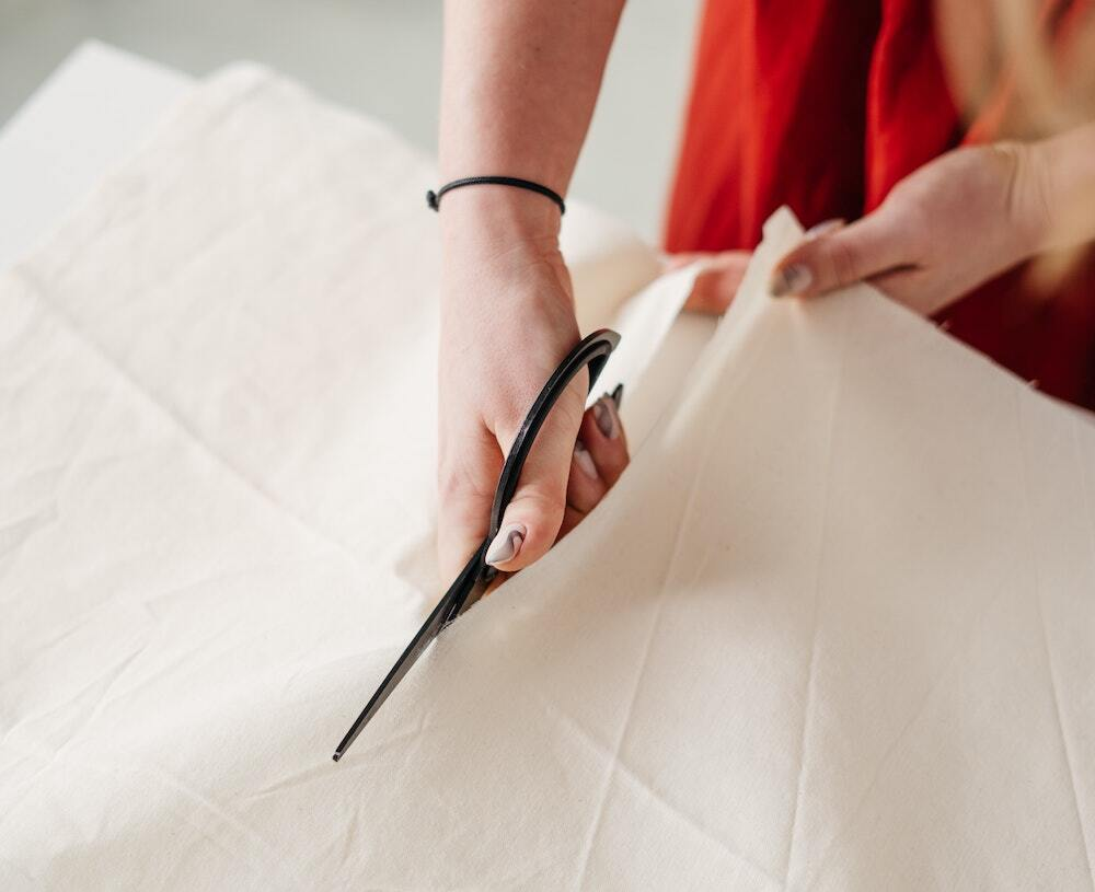 Person cutting fabric