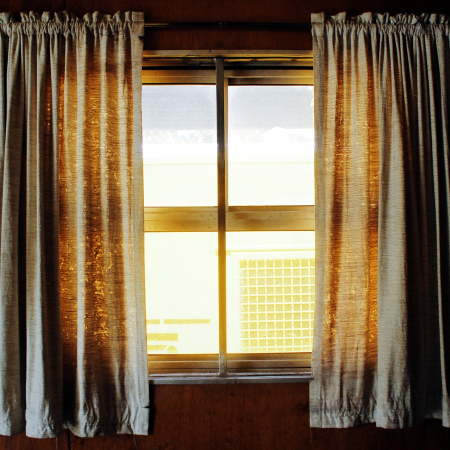 window with curtains and sunlight shining through