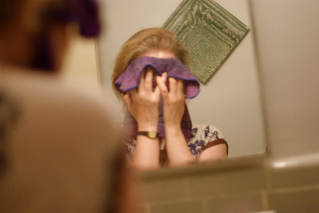 Teen washing face