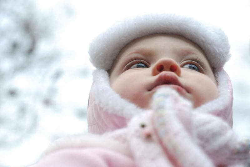 Child bundled up in the outdoors
