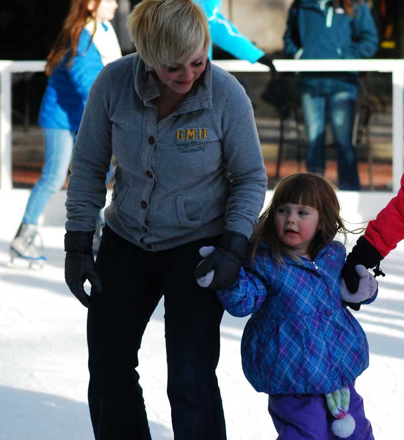 Mother and child ice skating