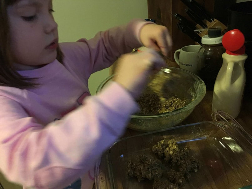 child helping to make homemade power bars for a healthy lunch