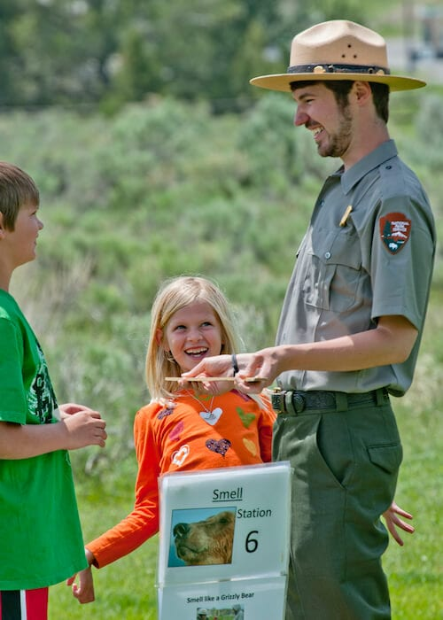 Park ranger leading kids on the Wildlife Olympics at Yellowstone.