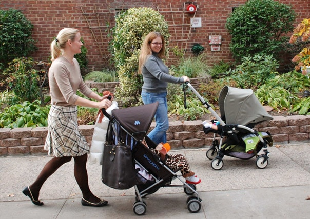 women getting exercise while walking with strollers