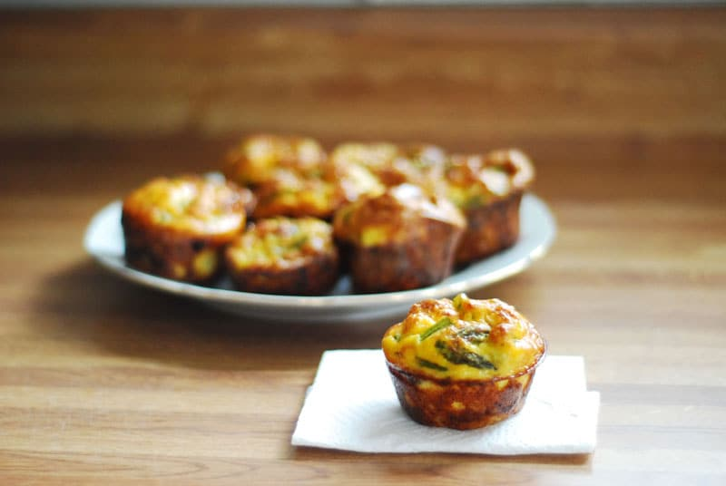 Small asparagus quiches on a plate