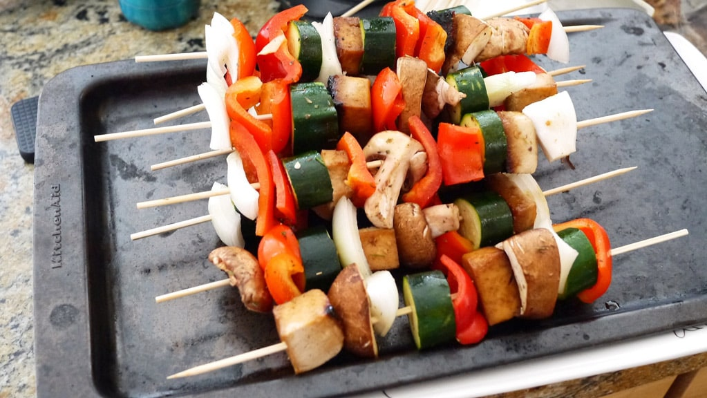 Tofu and veggie shish kabobs are filling and delcious as vegan cookouts.