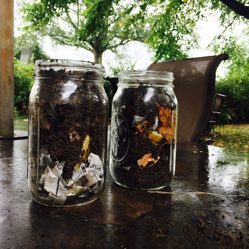 Making your own compost in a jar is among many games that teach composting for kids and adults alike.