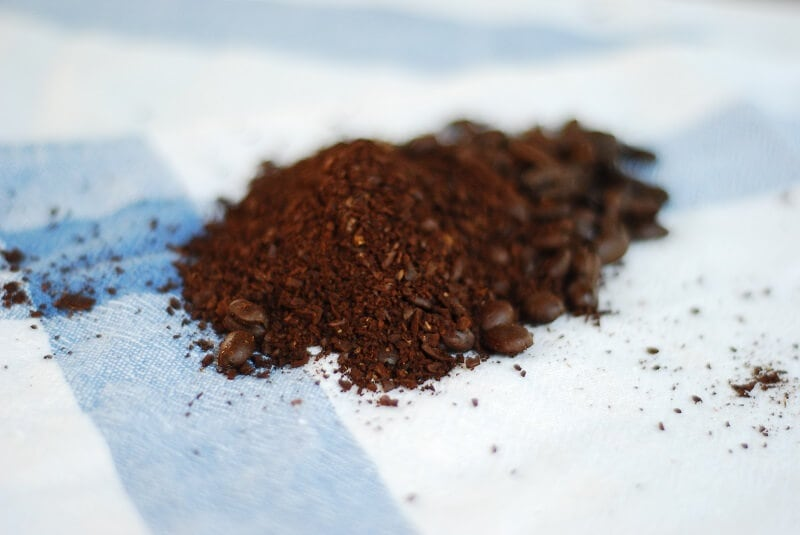 Recycle coffee grounds by reusing them as a natural food for earthworms in the compost pile.
