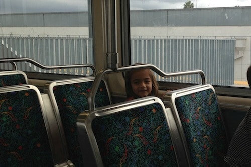 A child riding on a commuter train.