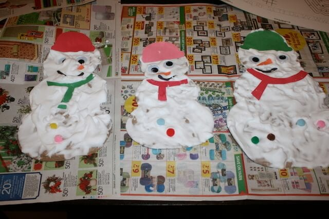 Snowmen made of recycled paper bags and shaving cream.